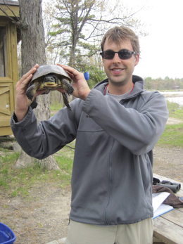 Bob Christensen holds a Blanding's turtle up to the camera.